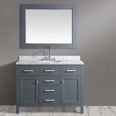 London Single Sink Vanity marble countertop and the contemporary cabinetry bring a crisp clean look to any bathroom. Included is a single oval ceramic sink, chrome finish pop-up drain and a large gray frame mirror.