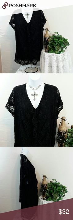 LANE BRYANT SZ 26/28 Lined Black Lace SS Top V-neckline with ruched center vertical ruffle. Short sleeves. Fully lined. Scalloped hem. Shoulder to shoulder 17.5 inches across. Arm pit to arm pit 26 inches across. Sleeve length 7 inches. Overall length from neck back to back hem bottom 26 1/4 inches. Great career or evening wear. Lane Bryant Tops Blouses
