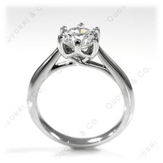 This Anastasia Designer inspired solitaire engagement ring features a DymondIX Round brilliant center from 1.00 carat to 4.00ct sizes. Beautifully hand-crafted with a graceful 6 prong entwined basket. This stunning design makes for a perfect Engagement ring. Available in Solid 14k, 18k Gold or Platinum.   An optional matching Anastasia Wedding Band is also available.   View the Anastasia Ring and Band Live by selecting the Product Video tab below.