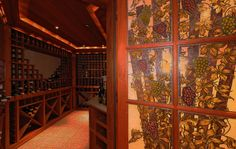 Wine Cellar with stained glass entry doors