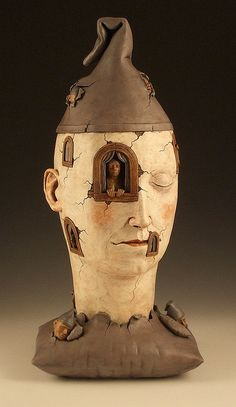 Avery Palmer  -  Dwellers of the Unconscious (front),  Glazed ceramic. Cone 03. 2009. 21x10x8in