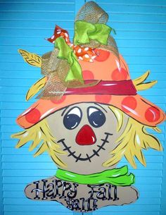This super cute scarecrow will surely be cute adorning your door during this fall season. The scarecrow is made from wood, hand-painted and Halloween Wood Crafts, Fall Crafts, Fall Halloween, Scarecrow Crafts, Scarecrows, Wood Craft Patterns, Wood Block Crafts, Fall Door Hangers, Wooden Door Hangers