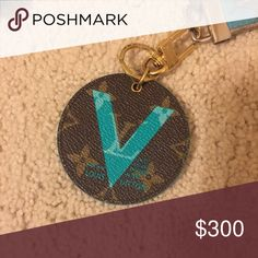 """Turquoise """"V"""" keychain Limited edition price. Comes with box, dust bag. Codes on it are M67221 and BC0135 I believe which would represent Spain 2015 according to my research. They are rather hard to read. Reasonable offers only please, I do not have the original receipt. Price is Final Louis Vuitton Accessories Key & Card Holders"""