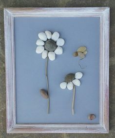 Pebble art flowers with cute little insect....listed in ETSY under CRAWFORD BUNCH...