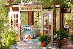Shadey Pergola retreat with old windows and  french doors.  Love it