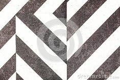 A close up of black and white striped paper.