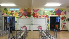 In Wentworth Primary School we brightened up their canteen with a bold fruit and vegetable themed mural around their serving hatch. Murals like this are very popular as they make the dining area fun as well as promote healthy eating. This mural took us four days to complete.
