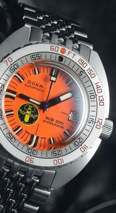 This year, Doxa has released a number of 'anniversary' timekeepers that celebrate the brand's first semicentennial in the business of making professional diving watches. Dream Watches, Cool Watches, Men's Watches, Stylish Watches, Wrist Watches, Fashion Watches, Men's Fashion, Citizen Watches, Analog Watches