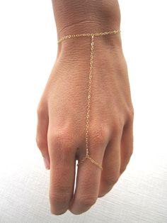 slave bracelet - hand chain // delicate 14k gold filled chain hand bracelet. $58.00, via Etsy.