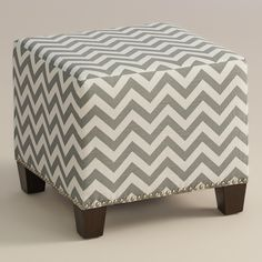 Featuring a fresh gray and white chevron print, our plush, custom-made ottoman is handcrafted in the U.S.A. with cotton upholstery and nail trim. Pair two ottomans at the foot of a bed for dramatic seating and coordinate with our bed or headboard in the same custom fabric for a pulled together look.