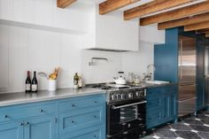 Love these blue cabinets! Kitchen with exposed timbers and Wood Mode cabinets in Brooklyn renovation by Elizabeth Roberts. Blue Kitchen Cabinets, Big Kitchen, Kitchen Cabinet Design, Kitchen Dining, Kitchen White, Upper Cabinets, Kitchen Vent, Prep Kitchen, Eclectic Kitchen