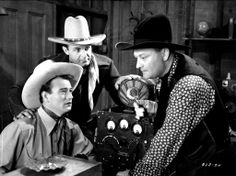 "From left, John Wayne, Ray Corrigan and Max Terhune play the Three Mesquiteers in ""Overland Stage Raiders"" (1938)."