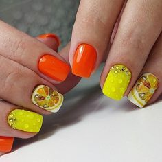 The Citrus Squeeze Nail Art Design. Show your love for citrus fruits with these bright yellow and orange lemon sliced nails.
