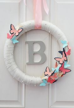 DIY Butterfly Wreath with Monogram in the center of the wreath. Free Printable Butterfly Template included.