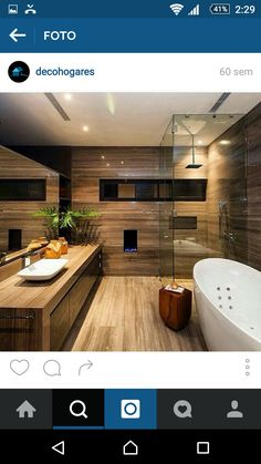 Beautiful modern style bathroom with large mirror, wooden floors, walls and vanity and a free standing bathtub. By: GLR Arquitectos Bathroom Design Luxury, Home Interior Design, Bathroom Designs, Luxury Bathrooms, Bathroom Wood Shelves, Wood Shelf, Teen Bedroom Designs, Cuisines Design, Sweet Home