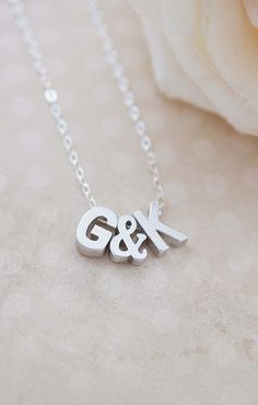 Sterling silver initial necklace from Earrings Nation! Perfect for Christmas presents, bridesmaid gifts, etc. http://www.earringsnation.com/jewelry/personalised-necklaces/matte-silver-initial-letters-capital-letter-and-ampersand-bead-personalized-initial-necklace#.VGJAUdZHiV5