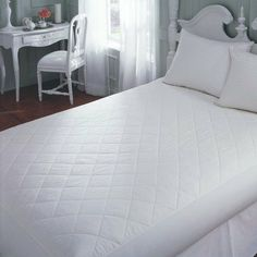 """Cotton Mattress Pad in White Size: 48"""" x 75"""" 14""""Depth by Downright. $72.00. MP-4875-COT-14 Size: 48"""" x 75"""" 14""""Depth Features: -Mattress pad.-Coland: White.-Material: 100pct Cotton.-Fully elasticized skirt.-Spandex candners. Options: -Available in multiple sizes."""