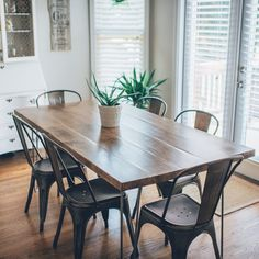 We wanted a kitchen table that was simple, neutral and could take a beating from us and the kids, but still develop some character over the years. It's 6 feet long x 3 feet wide, hard maple wood top with iron hairpin legs. I built the top and we purchased 4 hairpin legs. We left knots throughout...