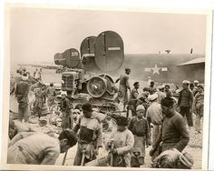 Building An Airbase In China With skillful hands trained by years of use, Chinese peasants lay a foundation of crushed riverbed stone during the construction of a forward base for the new B-29 Superfortresses. The machine shown, the only one used in the work, crushes the rock for the landing strips. The B-24's in the background landed before the field was completed.