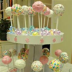 Cake pops using donut holes. Great Idea. Much easier!