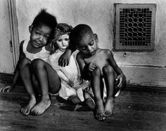 """""""Children with Doll, Washington, D.C."""" (1942) is one of the images captured by…"""
