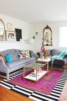 Eclectic printed rugs work together as long as one is mostly neutral, like a black and white stripe.