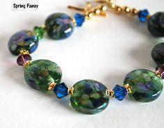 Green Crystal Bracelet Lampwork Glass Beads Purple Blue Swarovski Gold @bluemorningexpressions @saracom   #bmecountdown  - Jewelry on ArtFire