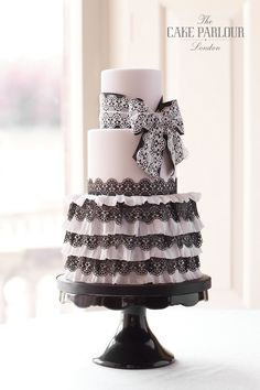 'LACE. RUFFLES & RIBBONS' Wedding Cake - Layers of sugar ruffles and lace surrounding the base tier topped with a layered lace sugar bow.