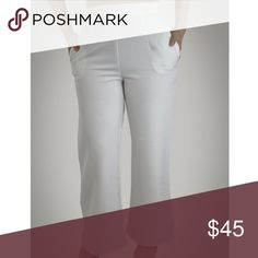 SALE ‼️ Din & Louie White Wide Leg Pants Pair this nice high waist wide leg pants with almost anything, it is perfect for any occasion, it makes your legs look longer, it shapes your body and it is comfortable.  This pants are a bit see through, I recommend to wear seamless nude underwear that matches your skin tone the best.  •Material: 100% Polyester •Functional Pockets  •Invisible Back Zipper Modeling: medium.  Ships within 48 hours (on business days). Din & Louie Pants Wide Leg