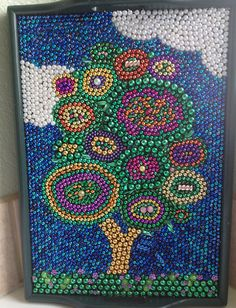 Inspired by others who've recycled mardi gras beads into art - I did it too! For sale in my etsy store.