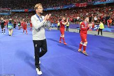 Liverpool manager Jurgen Klopp applauds the disappointed travelling supporters after the c...