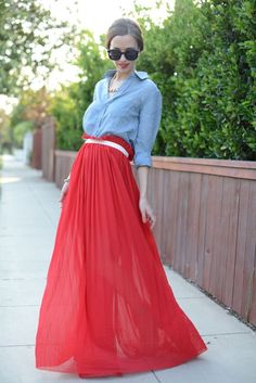 """""""I fell in love with this flowy red maxi skirt and thought it would be perfect dressed down with a blue chambray top. This is the perfect outfit for an outdoor BBQ because you'll stay cool and comfortable while still looking ultra chic. Plus, you gotta love maxis for protecting you against a nasty sunburn during the day and those pesky mosquito in the evening. These nude sandals are beautiful for warm weather, and the contrasting green ankle strap gives them a little something extra."""""""