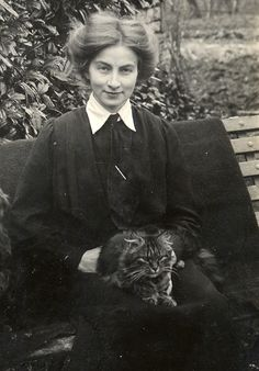Girl and cat, 1900s