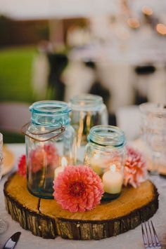Mason Jars on Wooden Slice - 24 Best Ideas for Rustic Wedding Centerpieces (with Lots of Picture Inspiration) - EverAfterGuide