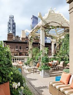 Traditional Outdoor Space by Mario Buatta in New York, New York