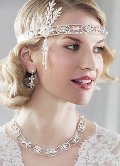 Do you want a Great Gatsby, Art Deco inspired hair accessory?  This band is beautiful and sparkles with silver crystal and pearls.  Perfect a bride on the wedding day, a black tie event or very special prom.
