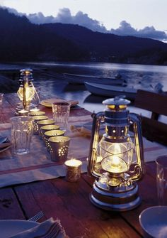 love the lantern & little cans with candles, maybe good idea for citronella candles in summer..