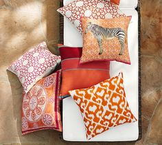 Mix and match our embroidered outdoor pillows with prints and solids for a…
