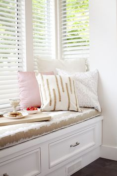 Make a window seat even more inviting with a pretty selection of colours like this