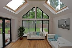 Large fixed windows complete with shaped gable windows create a bright and open living space Bungalow Extensions, Garden Room Extensions, House Extensions, House Extension Plans, House Extension Design, House Design, Living Room Extension Ideas, Rear Extension, Conservatory Interiors
