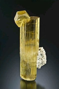 Heliodor:   Highly saturated yellow crystal of heliodor with a small one to top it off and a bit of matrix on the side Country: Brazil Locality: Capelinha