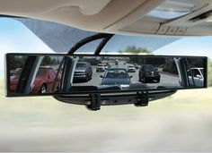 The patented, seamless mirror has a 180° field of view that provides a distortion-free reflection of rear traffic across an entire five-lane highway, and it allows continuous monitoring of adjacent vehicles from the moment they begin to pass until they are visible in your peripheral vision.    http://www.thefancy.com/sales/435/the-no-blind-spot-rear-view-mirror    $39.95.