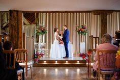 Wedding Ceremony Room at Bury Court Barn. Flowers by Hannah Berry Flowers. Pink colour scheme. Bury Court Barn Wedding - Laura and Andy - Tony Hart Photo - Wedding Photographer Hampshire | Tony Hart Photo Blog