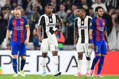 Barcelona's midfielder Andres Iniesta (L) and Barcelona's Brazilian forward Neymar (R) react during as Juventus' defender from Brazil Alex Sandro and Juventus' midfielder from France Mario Lemina (2ndR) during the UEFA Champions League quarter final first leg football match Juventus vs Barcelona, on April 11, 2017 at the Juventus stadium in Turin. Juventus won 3-0. / AFP PHOTO / MIGUEL MEDINA