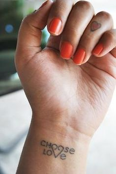 "very cute and feminine ""choose love"" tattoo"
