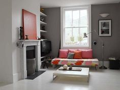 Grey walls, white fireplace (would look even better with a wooden floor)