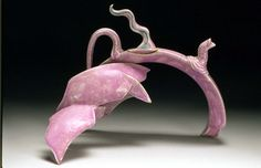 """Diving Purple Dolphin"" teapot. I wonder if the artist even drinks tea?     Love this"