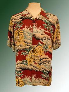 "Antique Tiger: Late 1940's Original Silky ""Talk Story: Stunning design and example of a pattern that arrived from the orient perhaps to be made into a kimono. The tiger crouching over splashing waves in rich vivid colors was made into an Aloha Shirt because thats what our visitors wanted!  Features: Matched pattern front. Coconut Buttons Condition: Mint       Fabric:  Silky"