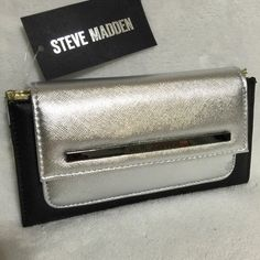 """Steve Madden Silver Black Color Block Wallet NEW WITH TAGS, Steve Madden Color Block Wallet  • Color: Metallic Silver / Flat Black • Interior Colors: Black / Silver / Gold / Pearl  • Dimensions: 8""""W x 4""""H x 1"""" • 12 credit card slots, 3 full length slip pockets, zipper compartment and a pocket under snap flap closure • Gunmetal Tone hardware   I have more STEVE MADDEN, Check out my other items!  ❌ NO TRADES Steve Madden Bags Wallets"""