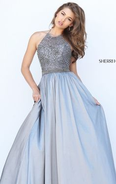 Feel the magic of Sherri Hill 50221. Halter neckline with mid-rise back flatters your slender shoulders with poise. The fitted bodice is highly crafted with beads that is very glamorous and feminine. Ball skirt falls down to a full length finish.
